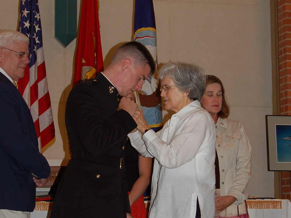 My grandmother pinning on the same wings my grandfather wore in World War II